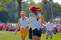 5th September 2021; Toledo, Ohio, USA;  Danielle Kang of Team USA hugs her caddie after winning on the 18th hole during the morning Four-Ball competition during the Solheim Cup on September 5th