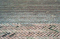 Siena:  Brickwork patterns--Piazza Del Campo.  Photo '83.