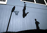 The shadows of Cody Lommori, left, and Matt Williams, both 14, are cast against the side of Cody's house on April 4, 2007, in Minden, Nev..Photo by Cathleen Allison/Copyright Nevada Appeal