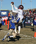 Bishop Gorman's Brevin Jordan makes a touchdown reception over Reed defender Kyeer Geisinger during an NIAA Division I playoff game at Reed High School in Sparks, Nev., on Saturday, Nov. 28, 2015. Bishop Gorman won 41-13. (Cathleen Allison/Las Vegas Review-Journal)