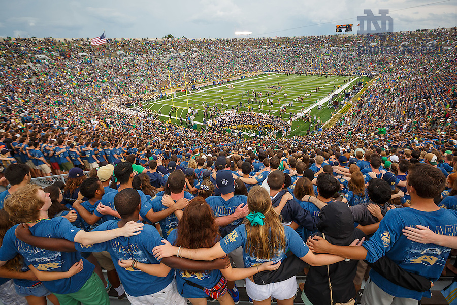 Aug. 30, 3014; The student section sings the Alma Mater with the football team after the season opening win over Rice.. Photo by Peter Ringenberg/University of Notre Dame