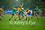 Action from Kerry v Clare in the Munster Junior Camogie final during a down pour