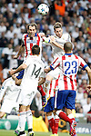 Real Madrid's Sergio Ramos (r) and Atletico de Madrid's Diego Godin during Champions League 2014/2015 Quarter-finals 2nd leg match.April 22,2015. (ALTERPHOTOS/Acero)