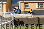 With spectator numbers limited to double digits some found alternative vantage spots to view the Piarsaigh na Dromoda v Glenbeigh-Glencar match at the Con Keating Park in Cahersiveen on Saturday evening.