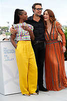 """CANNES, FRANCE - JULY 17: Fatou N'Diaye, French director Nicolas Bedos and Natacha Lindinger at photocall for the film """"OSS 117 : Alerte Rouge en Afrique Noire"""" (OSS 117 : From Africa With Love) at the 74th annual Cannes Film Festival in Cannes, France on July 17, 2021 <br /> CAP/GOL<br /> ©GOL/Capital Pictures"""