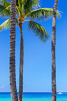 The mid-day sun highlights the blues of the waters of Waikiki Beach on Oahu, Hawaii.