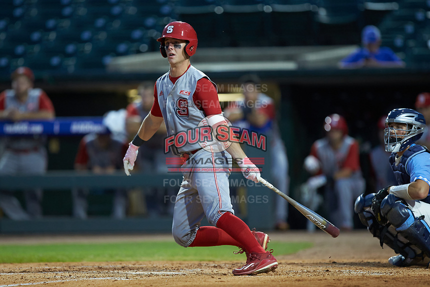 Evan Mendoza (18) of the North Carolina State Wolfpack follows through on his swing against the North Carolina Tar Heels in Game Twelve of the 2017 ACC Baseball Championship at Louisville Slugger Field on May 26, 2017 in Louisville, Kentucky. The Tar Heels defeated the Wolfpack 12-4. (Brian Westerholt/Four Seam Images)