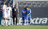 El Salvador's Rodolfo Zelaya (11) gets a pat on the chest from teammate Rudis Corrales (9) after scoring an El Salvador goal.  El Salvador defeated Cuba 6-1 at the 2011 CONCACAF Gold Cup at Soldier Field in Chicago, IL on June 12, 2011.