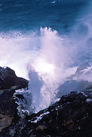 Halona blow hole spouting, near sandy beach on Oahu