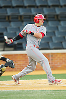Tarran Senay (32) of the North Carolina State Wolfpack follows through on his swing against the Wake Forest Demon Deacons at Wake Forest Baseball Park on March 15, 2013 in Winston-Salem, North Carolina.  The Wolfpack defeated the Demon Deacons 12-6.  (Brian Westerholt/Four Seam Images)