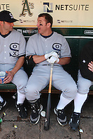 OAKLAND, CA - AUGUST 16:  From left: Paul Konerko #14 and Jim Thome #25 of the Chicago White Sox get ready in the dugout before the game against the Oakland Athletics during the 1929-themed turn back the clock game at the Oakland-Alameda County Coliseum on August 16, 2009 in Oakland, California. Photo by Brad Mangin