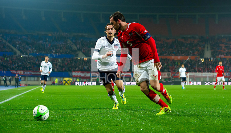 VIENNA, Austria - November 19, 2013: Mix Diskerud and Austria's Christian Fuchs during a 0-1 loss to host Austria during the international friendly match between Austria and the USA at Ernst-Happel-Stadium.