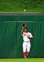 27 September 2010: Washington Nationals outfielder Nyjer Morgan pulls in a fly ball against the Philadelphia Phillies at Nationals Park in Washington, DC. Mandatory Credit: Ed Wolfstein Photo