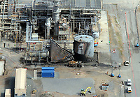 Pictured: Aerial view of the tank that blew up killing four workers at the Chevron oil refinery in Rhoscrowther near Pemroke Dock, Pembrokeshire, west Wales. Monday 06 June 2011.<br /> Re: The four people killed in the explosion and fire at the Chevron oil refinery in Pembrokeshire have been named.<br /> They were Julie Jones, 54, a fire guard from Pembroke, and three men from Milford Haven: Dennis Riley, 52, Robert Broome, 48, and Andrew Jenkins, 33.<br /> Ms Jones was a mother of one and grandmother, Mr Riley a father of two and grandfather, Mr Broome a father of seven and Mr Jenkins had young twins.<br /> A fifth person is critical but stable after Thursday's blast at Pembroke.<br /> Churches are opening their doors to allow people to say prayers for the victims, with books of condolence available and priests offering support.<br /> <br />  <br /> It could be some time before the cause of the explosion is known Dyfed-Powys Police said the bodies were removed from the scene on Friday night.