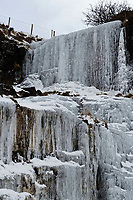 Pictured: A frozen over waterfall  in Storey Arms, Brecon Beacons, Wales, UK.<br /> Re: The Beast from the East wind has been affecting most parts of the UK with areas reaching temperatures below zero.