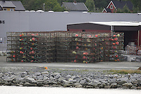King Crab Paralithodes camtschaticus or Kamchatka crab cages stacked at harbour prior to loading on boat. Kirkenes, Arctic Norway