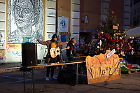 """Cane Sulla Luna (Nicola Pressi Singer, Songwriter, Musician).<br /> <br /> Rome, 19/12/2020. Today, the Nuovo Cinema Palazzo Community held a third public assembly (1.) in Rome's San Lorenzo district to protest against the eviction of the """"Nuovo Cinema Palazzo"""" completed by the Italian police forces in the early morning of the 25th of November and to demonstrate against the violent reaction of the Police forces when, in the evening of the same day, a large demo asked to have the chance to hold a public assembly in the square (Piazza dei Sanniti) of the cinema (2.). The public assembly of today saw the participation, performances, support & solidarity of the representatives of movements, actors, musicians, poets, students, artists, and citizens of San Lorenzo who told their stories and memories related to the famous Rome's Art and culture occupation.<br /> The Nuovo Cinema Palazzo was occupied the 15th of April 2011, when citizens, movements, workers of the entertainment industry reopened the former """"Palazzo Cinema"""" to prevent the opening of a casino/gambling space. The illegal occupation was intended as a public hub of art, culture, sport and politics, an open place for exchange, discussion, studies, caring and sharing.<br /> <br /> Footnotes & Links:<br /> 1. http://bit.do/fL2Vu<br /> 2. 25.11.2020 - Demo And Clashes Against Nuovo Cinema Palazzo Eviction in Rome's San Lorenzo: http://bit.do/fLxgz<br /> Previous Public Assemblies: http://bit.do/fLCr3 & http://bit.do/fL2VR & http://bit.do/fL2Y5<br /> Videos of the Event: http://bit.do/fL2Wc & http://bit.do/fL2V6"""