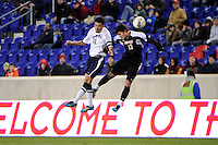 Carlos Alvarez (10) of the Connecticut Huskies and Brock Granger (13) of the Louisville Cardinals go up for a header. Connecticut defeated Louisville 1-0 during the first semifinal match of the Big East Men's Soccer Championships at Red Bull Arena in Harrison, NJ, on November 11, 2011.