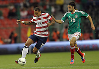 MEXICO CITY, MEXICO - AUGUST 15, 2012:  Jermaine Jones (13) of the USA MNT moves the ball away from Edgar Lugo (23) of  Mexico during an international friendly match at Azteca Stadium, in Mexico City, Mexico on August 15. USA won 1-0.