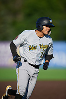 West Virginia Black Bears Fernando Villegas (25) rounds the bases after hitting a home run during a NY-Penn League game against the Auburn Doubledays on August 23, 2019 at Falcon Park in Auburn, New York.  West Virginia defeated Auburn 8-1, the first game of a doubleheader.  (Mike Janes/Four Seam Images)