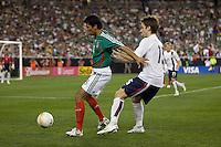 Mexico's Pavel Pardo holds off USA's Bobby Convey. USA 2, Mexico 0, at the University of Phoenix Stadium in Glendale, AZ on February 7, 2007.