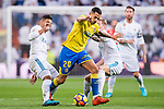 Victor Machin Perez of UD Las Palmas (C) fights for the ball with Carlos Henrique Casemiro (L), and Toni Kroos of Real Madrid (R) during the La Liga 2017-18 match between Real Madrid and UD Las Palmas at Estadio Santiago Bernabeu on November 05 2017 in Madrid, Spain. Photo by Diego Gonzalez / Power Sport Images