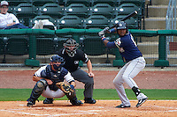 San Antonio Missions third baseman Duanel Jones (17) at bat in front of catcher Micah Gibbs and umpire Lee Meyers during a game against the NW Arkansas Naturals on May 31, 2015 at Arvest Ballpark in Springdale, Arkansas.  NW Arkansas defeated San Antonio 3-1.  (Mike Janes/Four Seam Images)
