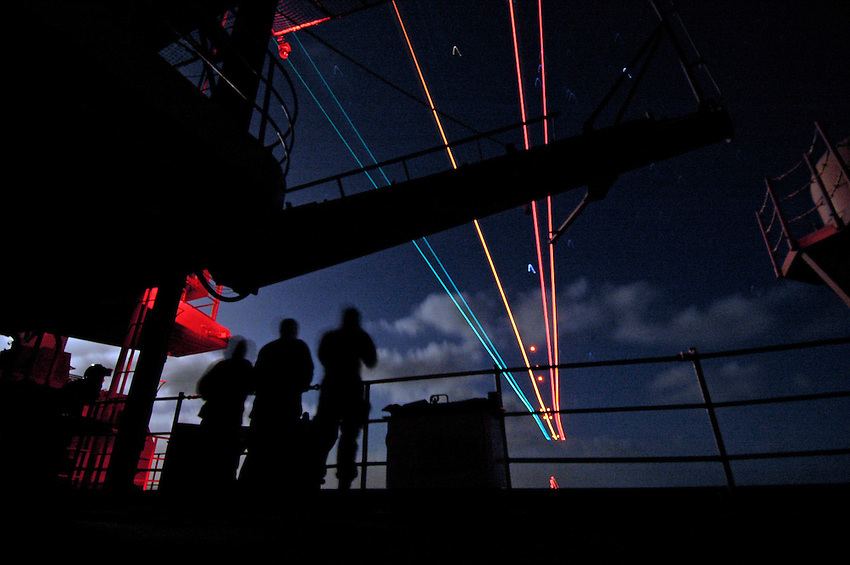 060116-N-7981E-001 Pacific Ocean (January 16, 2005)- Sailors watch from the fantail as an F/A-18C makes a night landing aboard the Nimitz-class aircraft carrier USS Abraham Lincoln (CVN-72). The Lincoln is currently conducting flight operations off the coast of California. U.S. Navy photo by Photographer's Mate Airman Apprentice James R. Evans (RELEASED)