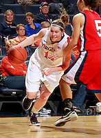CHARLOTTESVILLE, VA- December 7: Lexie Gerson #14 of the Virginia Cavaliers handles the ball during the game against the Liberty Lady Flames on December 7, 2011 at the John Paul Jones arena in Charlottesville, Va. Virginia defeated Liberty 64-38. (Photo by Andrew Shurtleff/Getty Images) *** Local Caption *** Lexie Gerson