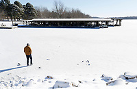 Christian Vidal turns to a friend Tuesday, February 16, 2021, as he stands on a frozen section of Lake Fayetteville near the levee. Temperatures dipped to 20 degrees below zero in some parts of the region over night Monday. Check out nwaonline.com/210217Daily/ and nwadg.com/photos for a photo gallery.<br /> (NWA Democrat-Gazette/David Gottschalk)
