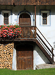Italy, South Tyrol, Valle di Anterselva, farmhouse, balcony, staircase, flowers, pile of wood
