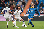 Marcelo Vieira Da Silva (c) of Real Madrid battles for the ball with Daniel Wass of RC Celta de Vigo during their Copa del Rey 2016-17 Quarter-final match between Real Madrid and Celta de Vigo at the Santiago Bernabéu Stadium on 18 January 2017 in Madrid, Spain. Photo by Diego Gonzalez Souto / Power Sport Images