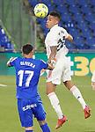 Getafe CF's Mathias Olivera (l) and Real Madrid's Mariano Diaz during La Liga match. April 18,2021. (ALTERPHOTOS/Acero)
