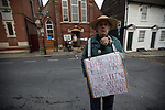 "© Joel Goodman - 07973 332324 . 20/11/2014 . Kent , UK . ) . Man wearing a placard reading "" Those whom De Lors hath joined let no white man put asunder "" . Polling station at Baptists Church Institute on Crow Lane , Rochester on polling day . The Rochester and Strood by-election campaign following the defection of sitting MP Mark Reckless from Conservative to UKIP . Photo credit : Joel Goodman"