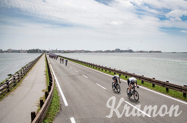 straight after kilometer zero, teammates Max Walscheid (DEU/Qhubeka ASSOS) & Victor Campenaerts (BEL/Qhubeka ASSOS) make a run for it accros the Grado Lagoon, only to be stopped 3 kilometers further where teh rac ewas neutralised because of a big crash behind them.<br /> <br /> 104th Giro d'Italia 2021 (2.UWT)<br /> Stage 15 from Grado to Gorizia (147km)<br /> <br /> ©kramon