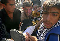 "Palestinian Fatah supporters carry a wounded old woman during clashes at a huge gathering in Gaza city, 12 November 2007. Gunfire erupted killing at least five demonstrators and wounding at least 10 in Gaza City today as hundreds of thousands gathered to mark the death of Yasser Arafat in the biggest rally organised by the Fatah party since its ouster by Hamas. Shots rang out after the crowds started chanting ""Shiite, Shiite"" -- accusing the Islamist movement of being a proxy for Shiite Iran and its ally Syria, witnesses and medics said.""photo by Fady Adwan"""