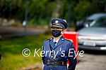 Chief Supt Eileen Foster stands to attention at the guard of honour at Paudie Twohigs by his Garda colleagues in Killarney on Tuesday.