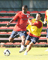 Landon Donavon (yellow) tugs on Maurice Edu during a practice session for the US men's national team at RFK auxiliary field on October 7, 2008 in Washington D.C. prior to the World Cup qualifying match against Cuba.