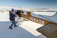 At the Galena airport, volunteer pilot Russ Dunlap loads people food boxes headed for Nulato into a plane flown by Dave Looney in the afternoon on Thursday March 12, 2015 during the 2015 Iditarod <br /> <br /> (C) Jeff Schultz/SchultzPhoto.com - ALL RIGHTS RESERVED<br />  DUPLICATION  PROHIBITED  WITHOUT  PERMISSION