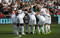 Swansea players huddle before kick off during the Premier League match between Swansea City and Watford at The Liberty Stadium, Swansea, Wales, UK. Saturday 23 September 2017