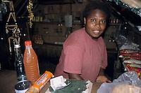 Portrait of young woman in a shop, Sulphur Bay Village, Ipekel Ipeukel, Tanna Island, Vanuatu.
