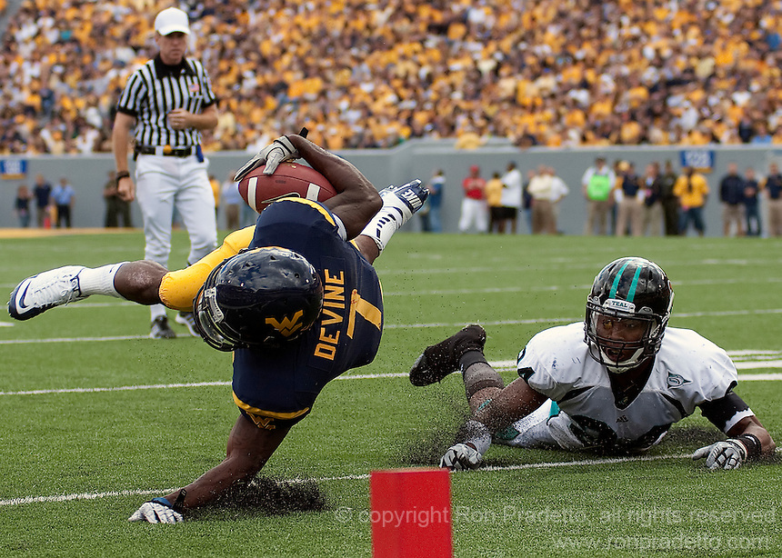 September 4, 2010: Noel Devine is tackled by Josh Norman. The West Virginia Mountaineers defeated the Coastal Carolina Chanticleers 31-0 on September 4, 2010 at Mountaineer Field, Morgantown, West Virginia.