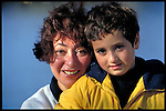 portrait of smiling young woman with young boy