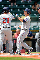 Fort Myers Miracle outfielder Andy Leer #12 is greeted by Matt Koch #20 after hitting a home run during a game against the Bradenton Marauders at McKechnie Field on April 7, 2013 in Bradenton, Florida.  Fort Myers defeated Bradenton 9-8 in ten innings.  (Mike Janes/Four Seam Images)