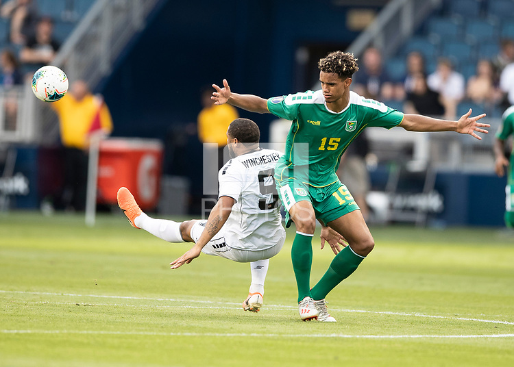 KANSAS CITY, KS - JUNE 26: Terence Vancooten #15 and Shahdon Winchester #9 battle for the ball during a game between Guyana and Trinidad