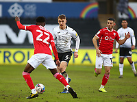 19th December 2020; Liberty Stadium, Swansea, Glamorgan, Wales; English Football League Championship Football, Swansea City versus Barnsley; Jay Fulton of Swansea City runs with the ball as he approaches Oduor of the Barnsley defence