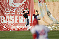 Batavia Muckdogs right fielder Jerar Encarnacion (27) tracks a fly ball at the wall during a game against the Auburn Doubledays on June 15, 2018 at Falcon Park in Auburn, New York.  Auburn defeated Batavia 5-1.  (Mike Janes/Four Seam Images)