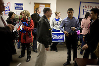 Volunteers gather at the Mitt Romney New Hampshire campaign headquarters in Manchester, New Hampshire, on Jan. 7, 2012. Romney is seeking the 2012 Republican presidential nomination.