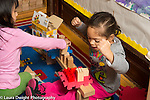 Education Preschool 3 year olds two girls playing together with blocks