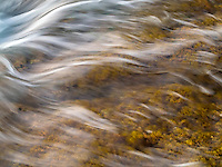 The fast flow of the ocean over seaweed (or limu), Kailua-Kona, Big Island.